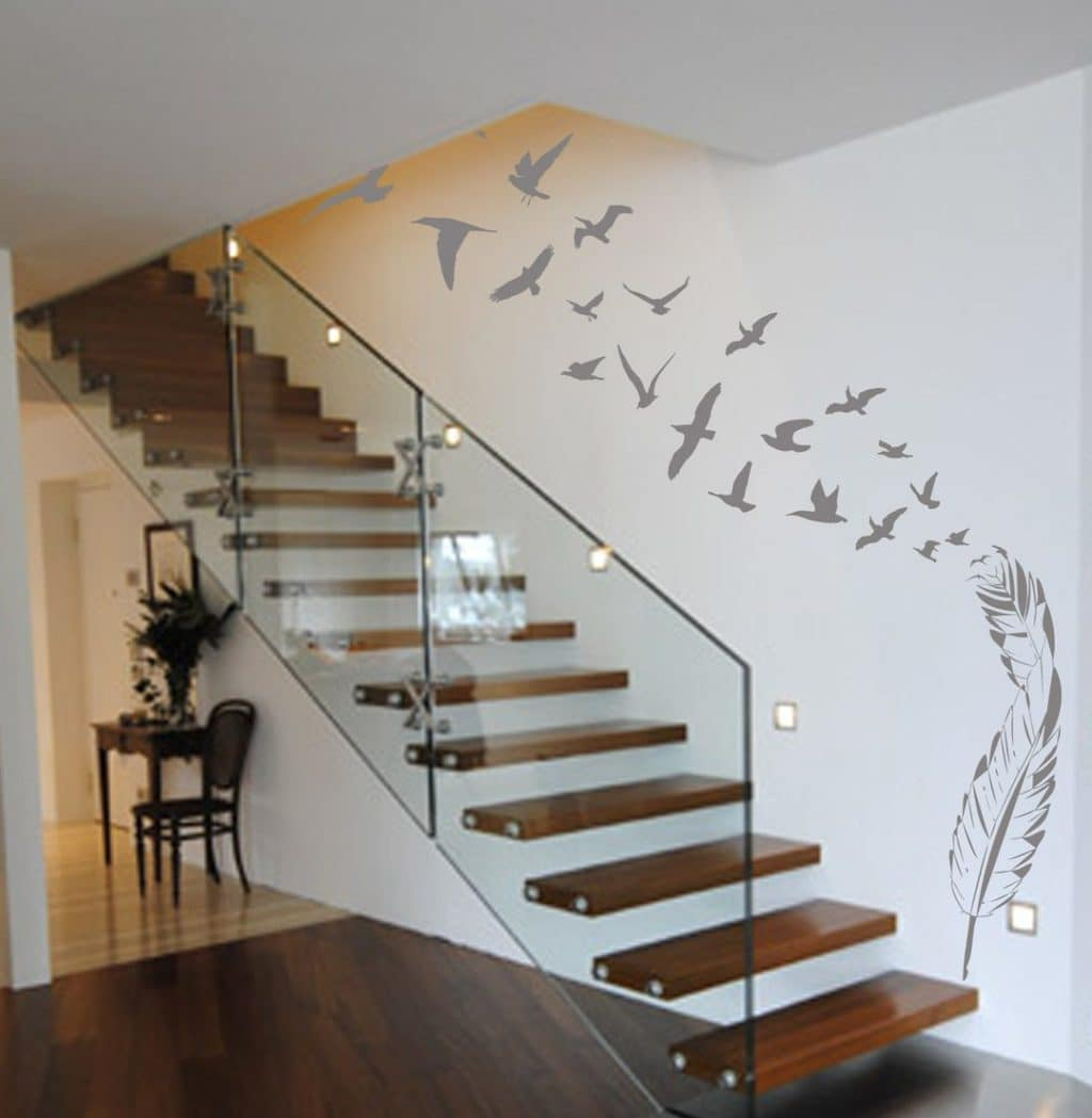 Birds flying out of feather wall art decal